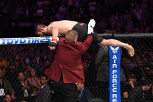 Nurmagomedov vaults the cage in pursuit of Dillion Danis, McGregor's jiu-jitsu coach.