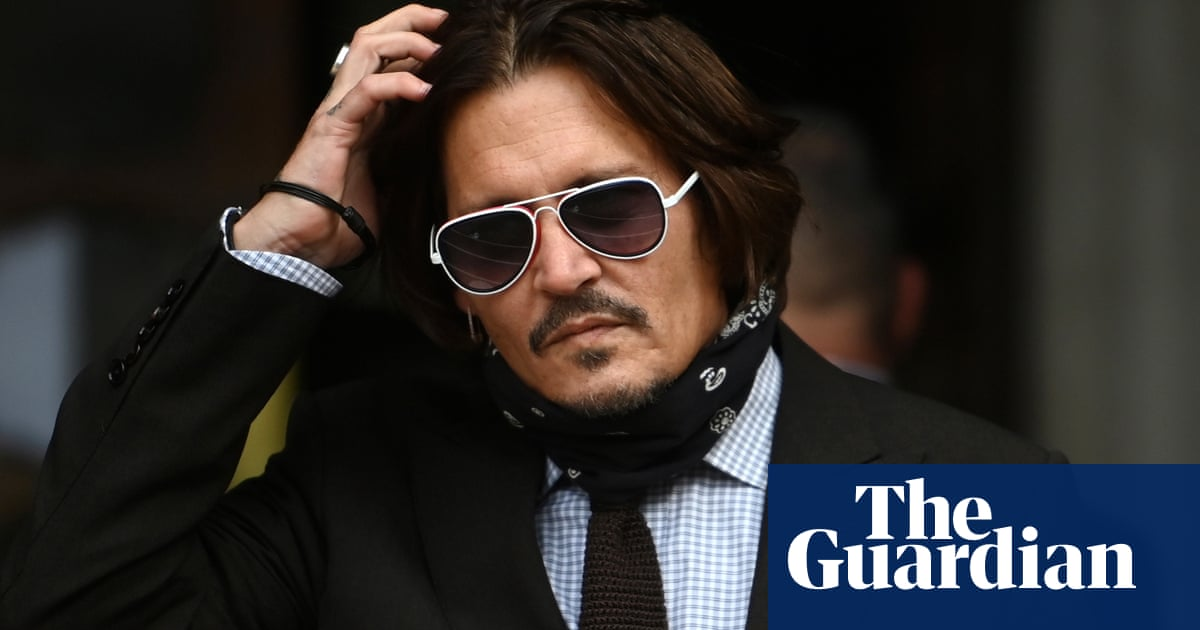 Dior sticks by Johnny Depp in defiance of wife beater ruling