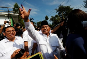 Indonesian presidential candidate Prabowo Subianto shows his ink-stained finger after voting at a polling booth during elections in Bogor, West Java.
