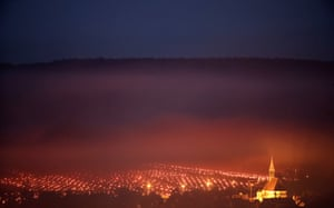 Heaters are lit early in the morning to protect vineyards from frost damage outside Chablis