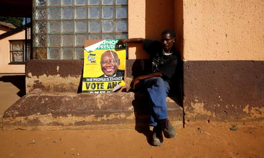 An ANC supporter with a poster of President Cyril Ramaphosa