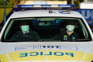 Police officers wear facial masks as they patrol in Wolverhampton, UK, on Tuesday
