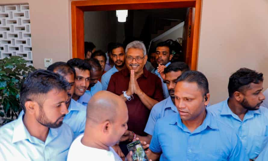 Gotabaya Rajapaksa gestures to supporters and well-wishers outside his house in Colombo.