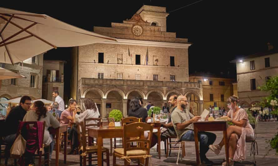 Outdoor tables of a restaurant in the main square of the medieval town of Montefalco.