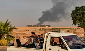 Civilians flee as Turkish forces bombard Ras al-Ain, a town in north-east Syria
