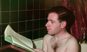 Theatre producer Peter Brook reading a script in the bath (1949)