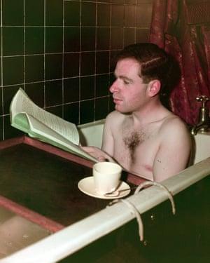 Brook reading a script in the bath in 1949.