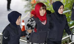 Vietnamese Doan Thi Huong is escorted to court in Shah Alam, Malaysia, on Thursday to face trial over the murder of Kim Jong-nam.