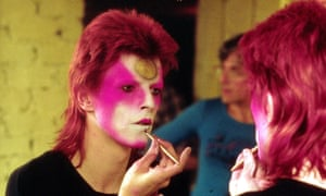 'We reinvented culture how we wanted – with great big shoes' … David Bowie gets ready for a gig in 1973.