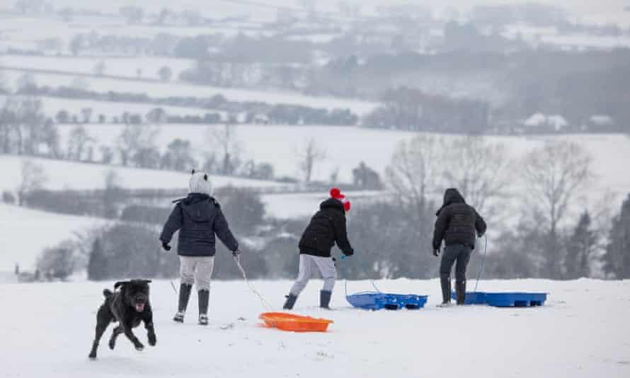 Children sledging at Farthing Common near Folkestone, Kent