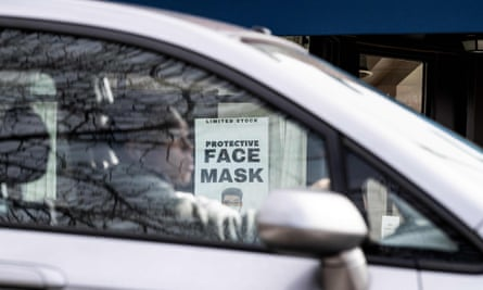A sign is seen in the window of a coronavirus pop-up store in Washington DC, on 6 March 2020.