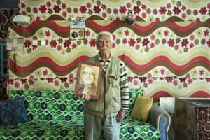 Kayseri, Turkey Huseyin Akyol, the son of a veteran of the Turkish war of independence, Necip Akyol, poses for a photo with his father's portrait and medal. Many families of soldiers who fought in the war from 1919 keep their medals to pass down the generations
