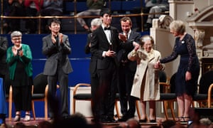 Dame Fanny Waterman congratulates Eric Lu at the ceremony at Leeds Town Hall, with Lang Lang (second right) and Gillian Moore (right)