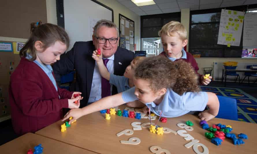 Headteacher Simon Kidwell with children