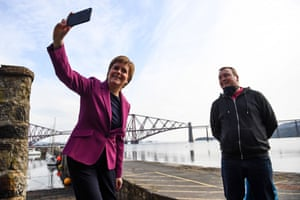 South Queensferry, Scotland Scotland's First Minister and leader of the Scottish National Party (SNP), Nicola Sturgeon takes a selfie photograph with a member of the public while campaigning with Edinburgh Western candidate Sarah Masson (unseen) ahead of the upcoming Scottish Parliament election which is to be held on May 6, 2021