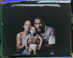 Diana Felix and Carlos Alberto Dias, pose with their son, Ezequiel. Dias stopped working to help Felix care for their four children. Sometimes he accompanies her to Ezequiel's therapy sessions and medical appointments, which can be as often as five times a week