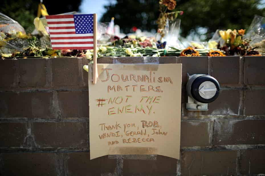 Flowers and a hand-written note laid outside the Capitol Gazette offices in Annapolis, US