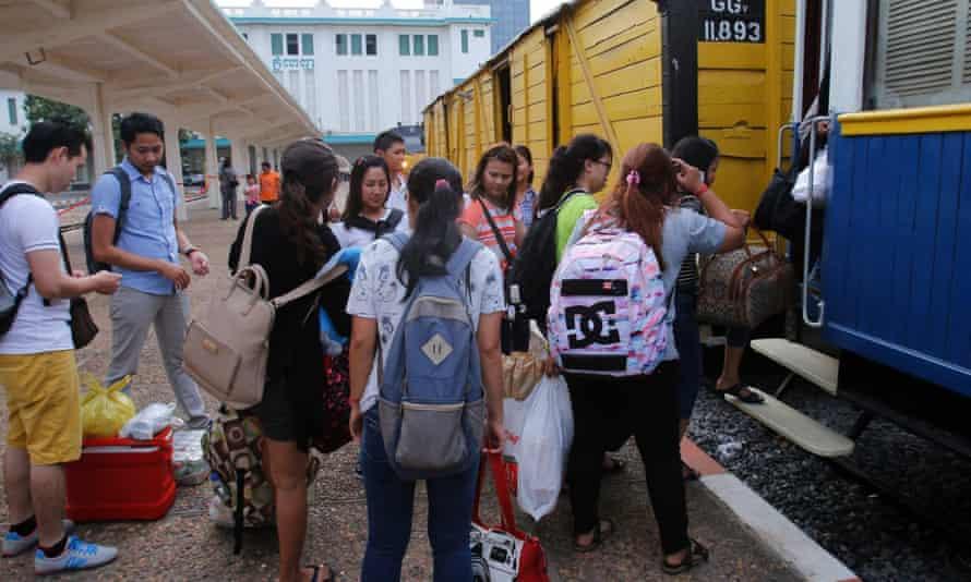 Passengers board in Phnom Penh.