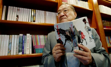 Novelist Louis Cha, who writes under the name Jin Yong, pictured in 2002, died after a long illness, aged 94.