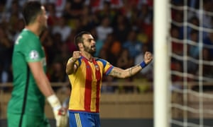 Álvaro Negredo celebrates scoring the early goal which eventually proved decisive for Valencia at monaco in the Champions League play-off second leg.