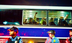 Detained demonstrators are taken to the police station by buses at the end of protest marches against racism and issues with the presidential election, in Minneapolis, Minnesota.
