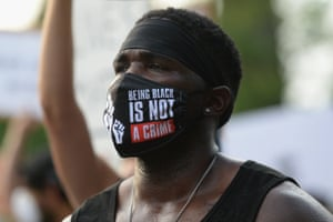 St Louis, US A protester demonstrates against racism and police brutality in Missouri