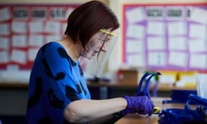 A volunteer at Ysgol Clywedog in Wrexham, north Wales, making 3D-printed visors. The hub is functioning around the clock.