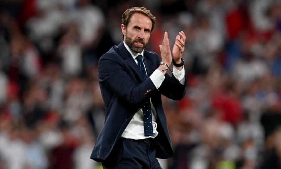 Gareth Southgate acknowledges England's fans after the semi-final victory against Denmark