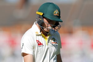 Australia's Marnus Labuschagne blows a bubble as he trudges off after losing his wicket LBW to England's Jofra Archer.