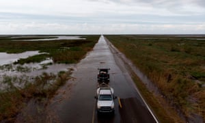 This aerial view shows Highway 27 flooded by storm surge from Hurricane Laura August 27, 2020, in Creole, Louisiana.