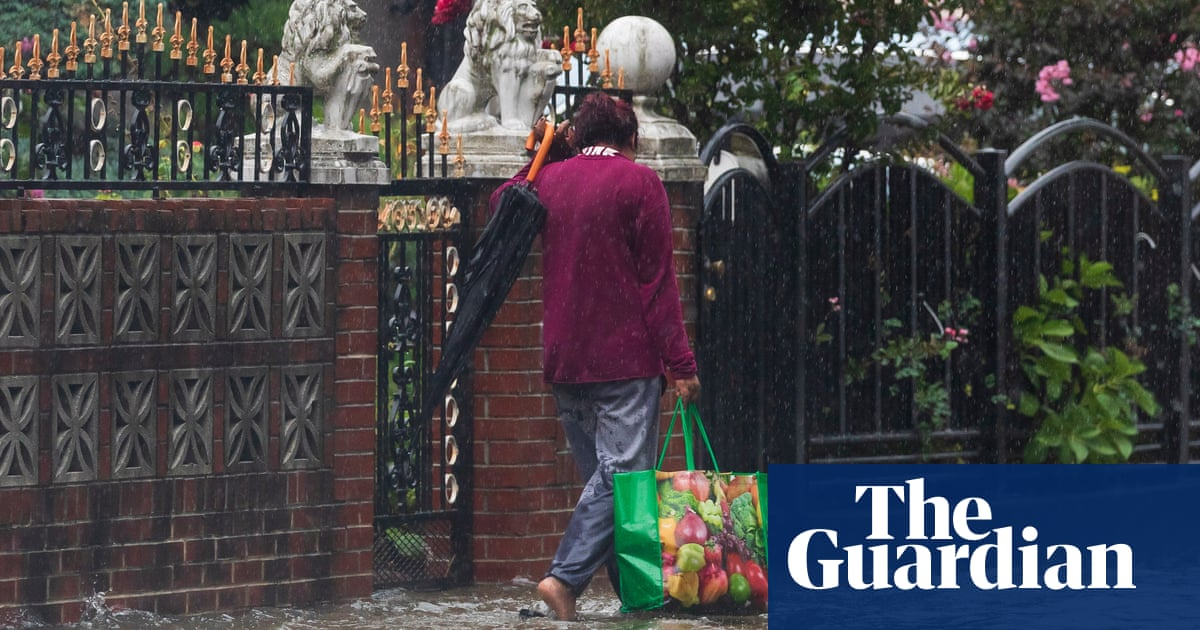 Henri drenches US north-east as 140,000 lose power in slow-moving storm
