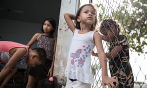 Children play at Criança Feliz, an invaded office that now works as a residency for Venezuelan migrants in Boa Vista, Brazil.