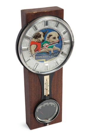 A 1960's wood-mounted clock and barometer.