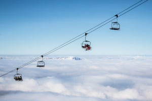 Ski Lifts Above Cloudscape Against Clear SkyGettyImages-663783093