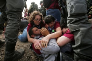 Israeli forces detain activists during a protest against what organisers say are the demolition of Palestinian houses by Israel in Yatta in the Israeli-occupied West Bank.