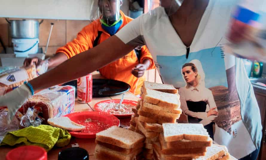 Volunteers in South Africa prepare food parcels during lockdown: 'South African's approach stands in stark contrast with Jair Bolsonaro's denialism or Donald Trump's divisive actions.'