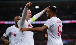 Callum Wilson celebrates scoring the third with Wayne Rooney.