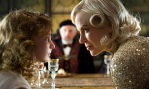 a still from the screen version of Northern Lights, The Golden Compass starring Dakota Blue Richards (left) as Lyra.