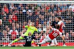 Pickford dives to save the shot from Monreal.
