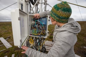 Scientist Roxane Andersen checks the electronics of an eddy flux tower, an instrument that measures the level of CO2 in the air flowing over the bog in the Forsinard Flows reserve