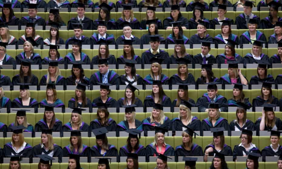 Students attend a graduation at a ceremony