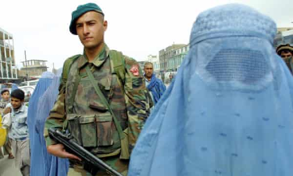 A Turkish soldier on patrol in Kabul, April 2002.