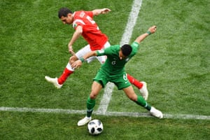 Russia's Andrey Semenov, left, and Saudi Arabia's Mohammed Al-Breik tussle for the ball