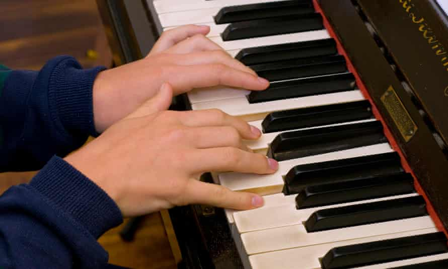 Girl's hands on piano keyboard