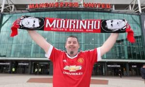 Manchester United fan John Bartrum holds up a Jose Mourinho scarf outside Old Trafford