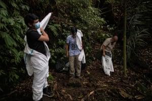 Virus hunters put on personal protective equipment