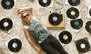 Woman on floor surrounded by records