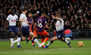 Manchester City's Riyad Mahrez sweeps the ball home to open the scoring.