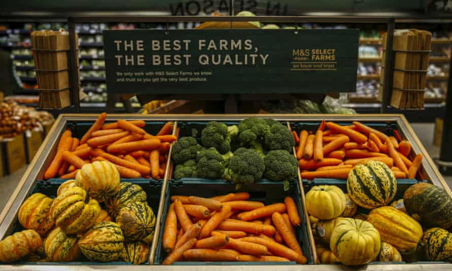 Pumpkins, carrots and broccoli on sale in the fresh food section of a Marks & Spencer store.