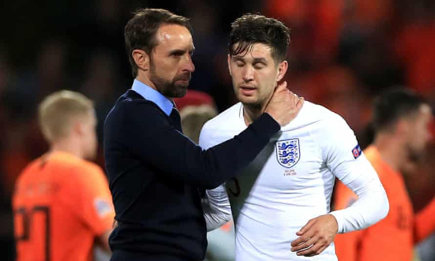 Gareth Southgate consoles John Stones at the end of the game, after his error enabled the Netherlands to take the lead in England's 2019 Nations League semi-final